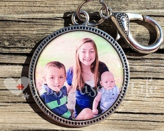 Silver keychain with personal photo set in resin