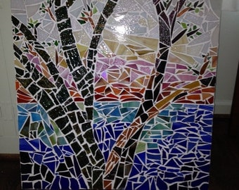 Beautiful mosaic wall hanging made with stained glass pieces, plywood backing, and grout.