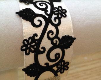 Creme ribbon cuff bracelet with black velvet appliqué