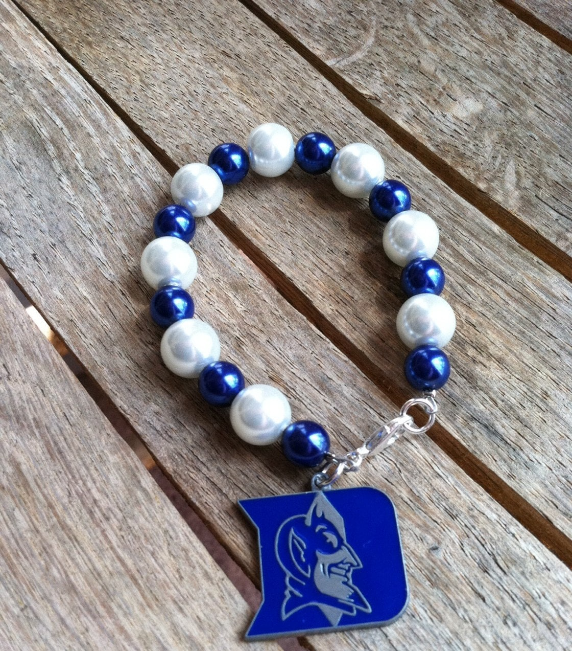 acc handmade ncaa teams beaded charm bracelet br 111014 03. Black Bedroom Furniture Sets. Home Design Ideas