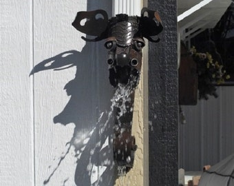 A Gothic style true Gargoyle roof drain downspout