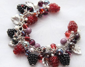 Glass lampwork bracelet with wild berries and silver-color leaves. Crimson and black colors.