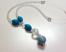 Handmade Gorgeous Aqua Blue Drop  Pendant set on wire thread, silver plate clasp