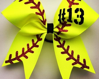 """Softball bow with your number. approximately 6""""by6"""".  Ask about bulk discounts, color and mascot options."""