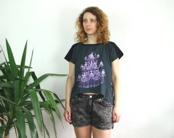 Women's blouse\ tshirt with chandelier print on the front.