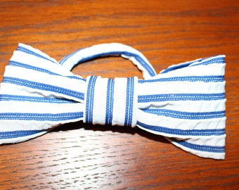 Set of 8 blue striped bow tie napkin rings