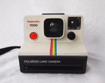 White Polaroid Supercolor 1000 Land Camera with rainbow stripes