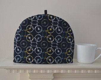 Bicycle Thief! - Thermally Insulated Artisanal Tea Cozy -  Geometric Bicycles Abstracted on Slate Background