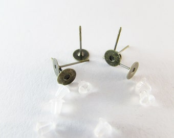 D-00280 - 20 Ear stud bases ant. bronce 6mm