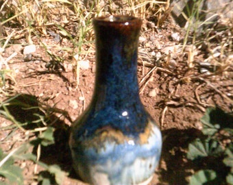 small blue and brown pottery bottle vase