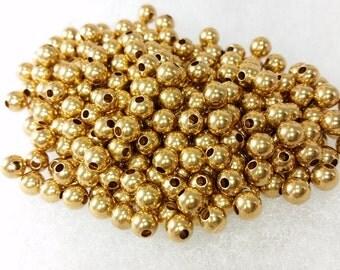 5mm solid brass beads, qty: 50,  round, 1.5 mm hole, anti-tarnish finish,  5 mm    50 beads