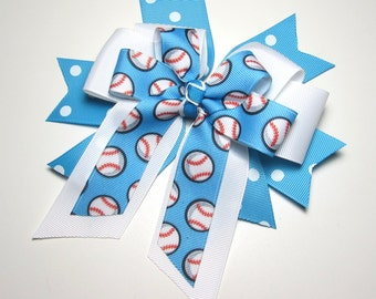 Softball Bow - Carolina Blue and White Polka Dot Spikes with White Center Bow and topped with a Softball Bow of Carolina Blue & Softballs