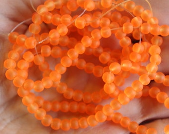 200 approx. 4 mm orange  frosted glass beads, round and smooth, one strand for making jewelry