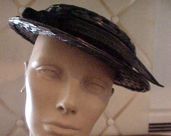 1950s Navy Straw with Velvet band and bow.  Has wonderful Feather.  Brim is 1 3/4""