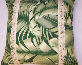 Upscale green tropical pillow with palm trees and twisted bouillion fringe accent