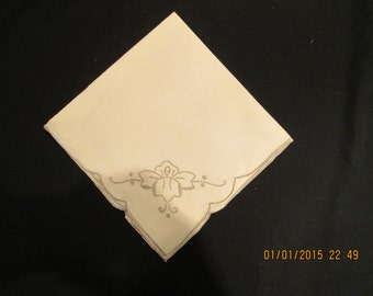 11 Cream colored napkins embroidered with darker beige