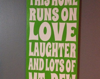 This home runs on love laughter and lots of Mountain Dew hand painted wood sign