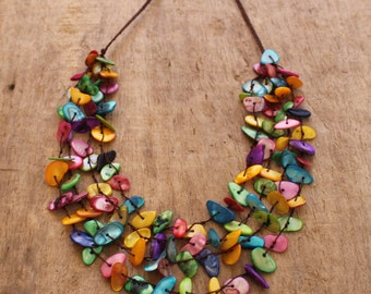Full Color Necklace. Cotton string and pieces of shell.