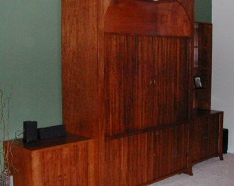 Custom built entertainment center. Tambour doors. Made in Cherry.