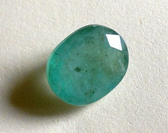 2.71 Ct. Natural Brazilian Emerald. Certified, clean and smooth surface, lively leaf green color. Big face gem (10 mm).