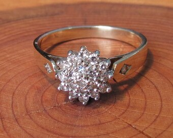 A vintage 9k yellow gold 0.4 Carat diamond star cluster ring.