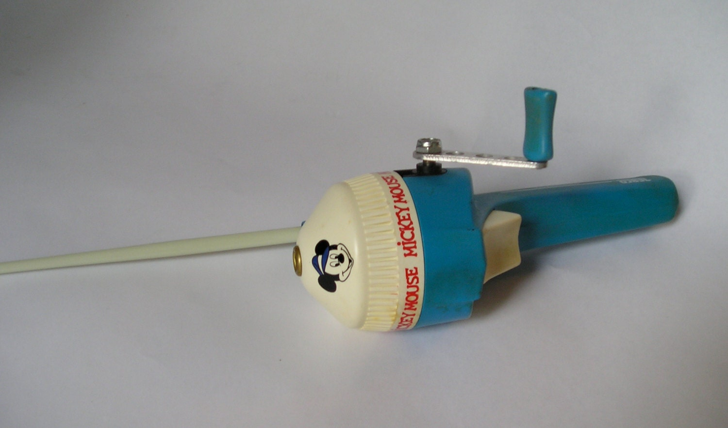 Vintage childs zebco blue mickey mouse fishing rod and reel for Blue fishing rod