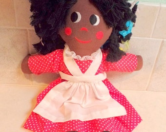 This is a sweet, black girl (Topsy) doll.  She may have been hand-made.