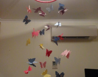 These beautiful mobiles hang from the ceiling.  Made from cardstock.