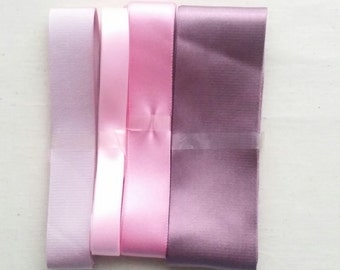 Pink, violet, purple satin/grosgrain ribbon of various widths/lenghts.