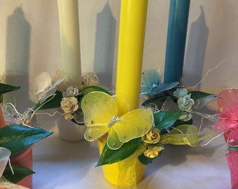 Cute flower pot taper candle holders.