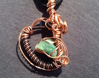 Chrysicolla nest. Wire wrapped pendant.