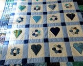 Hearts and Hexies applique baby quilts, one blue and one pink. Custom order reserved for Paula