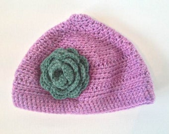 Pink Crochet Hat with Green Flower