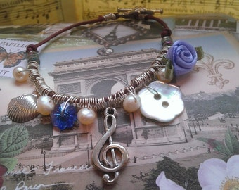 Charmed Bracelet- with Silver plated Treble Clef & Seashell Charms, Mother of Pearl Button, Swarovski Crystal and Silk Rose decoration
