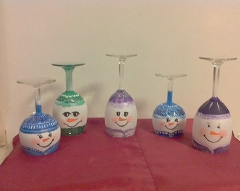 Items similar to hand painted snowmen wine glass candle for Beach wine glass candle holders