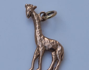 9 ct solid gold charm of a giraffe