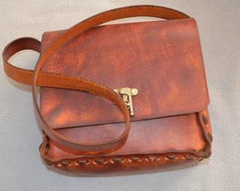 Antique brass closure tops off this classic leather pocketbook.