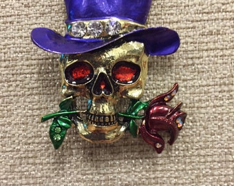 Glitzy skull with purple top hat and red rose