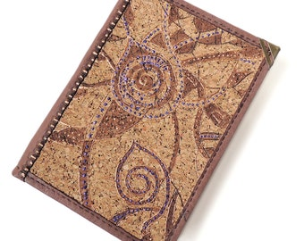 notebook with a cover of cork,