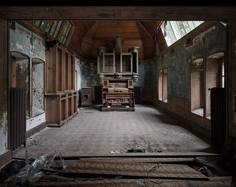 Photography of an abandoned organ room in a castle in France