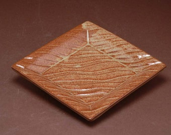 Small square tray; relief pattern dipped in a warm toast glaze