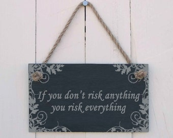 A Natural Slate Hanging Sign etched with the message 'If you don't risk anything you risk everything' (SR302)