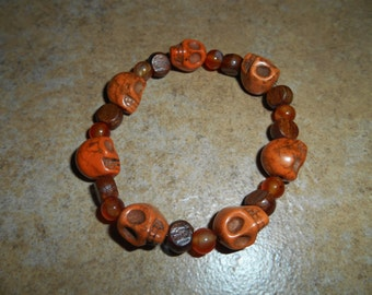 Crystal Skull Bracelet with wood and Carnelian beads