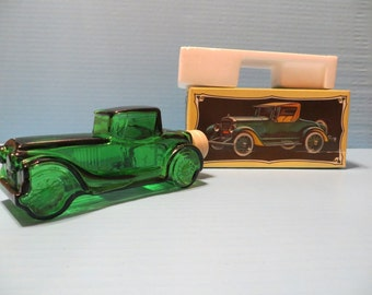 Old Avon car bottle Sterling Six II with box and original packing from 1973-74 is green glass with white tire cap, 6 7/8 inches long