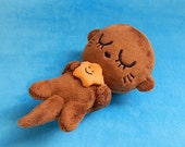 Sleeping Baby Otter + Orange Starfish plush