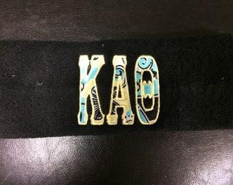 Kappa Alpha Theta Fleece Earwarmers with Official Kappa Alpha Theta Lilly Fabric