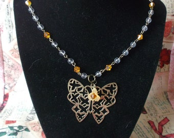 Antiqued Bronze Butterfly Necklace with Topaz Accents