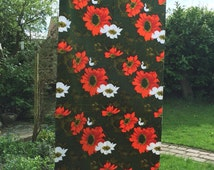 Over 3 metres of stunning quality, heavy, dark green, vintage fabric with huge orange and white flowers