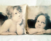 "Separable set of two pillow covers ""Raphael 's angels"" or ""Cherubs"" painted by Raphael. Cushion covers, throw pillows, pillow cases."