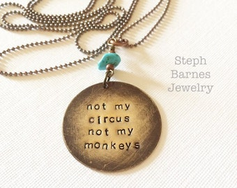 Not my circus not my monkeys necklace with turquoise detail in bronze